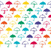 Seamless pattern with rainbow colored umbrellas. Royalty Free Stock Photos