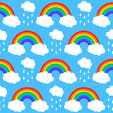 Seamless pattern with rainbows and clouds on a blu Royalty Free Stock Photos