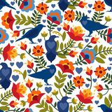Seamless pattern with raven, symbols of the heart and flowers. Background with flat shapes in blue, green, red, orange and yellow. Colors. Texture in ethno Royalty Free Stock Images