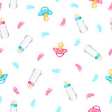 Seamless pattern from realistic pink and blue pacifiers, baby bo Royalty Free Stock Photos
