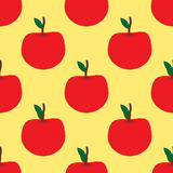Seamless pattern with red apples on the yellow background Stock Photo