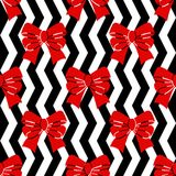 Seamless pattern. Red bows on a black and white background. Vector royalty free illustration