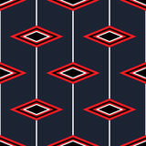 Seamless pattern with red diamonds on a blue background. Stock Image