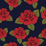 Seamless pattern of red flowers roses, texture. Red buds, petals, green leaves on a blue background. Wallpaper, paper, wrapper, pa Royalty Free Stock Photography