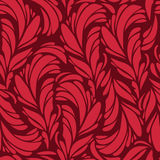 Seamless pattern with red and gold feathers. Texture Stock Images