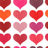 Seamless pattern with red hearts. Different red hearts on a white background. Royalty Free Stock Photo