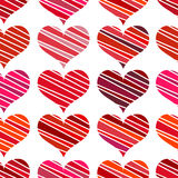 Seamless pattern with red hearts. Different red hearts on a white background. Stock Photos