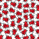 Seamless pattern of red hearts punctured by nails Royalty Free Stock Photos