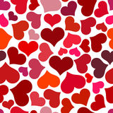 Seamless pattern with red hearts. Swirling red hearts on a white background. Stock Photography