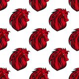 Seamless pattern of red horses heads Stock Image