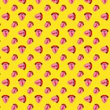 Seamless pattern with red hot chili pepper on the tongue. The girl shows tongue. Pop art style red lips on a yellow polka dot stock illustration
