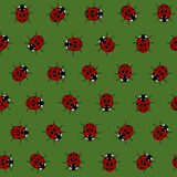 Seamless Pattern with Red Ladybugs and Ladybirds on a Dark Green Background. Stock Photo