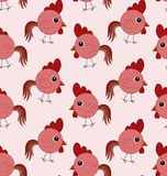 Seamless pattern with red roosters. Seamless pattern with funny cartoon red roosters on the pale pink background Stock Images