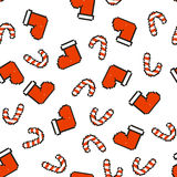 Seamless pattern with red socks for gifts and a striped red-and-white Lollipop. Christmas, new year background Royalty Free Stock Photo