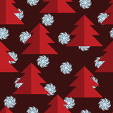 Seamless pattern with red trees and blue snowflakes. Christmas background. Burgundy background. Royalty Free Stock Photo