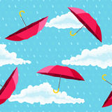 Seamless pattern with red umbrellas, clouds and raindrops Stock Photos