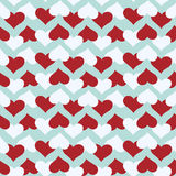 Seamless pattern with red and white hearts over blue background. Royalty Free Stock Image