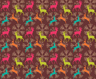 Seamless pattern with reindeers and christmas snowflakes Royalty Free Stock Images