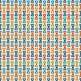 Seamless pattern with repeated hourglass. Ethic and tribal motif. Geometric abstract background. Stock Photography