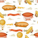 Seamless pattern with retro air transport. Vintage aerostat airship, blimp and plain in cloudy sky Royalty Free Stock Photography