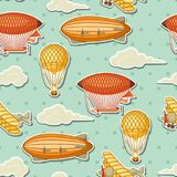 Seamless pattern with retro air transport. Vintage aerostat airship, blimp and plain in cloudy sky Stock Image