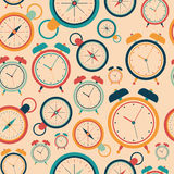 Seamless pattern with retro alarm clocks and pocket watches. Royalty Free Stock Images