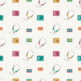 Seamless pattern with retro audio players, tapes, headphones. Royalty Free Stock Image