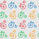 Seamless pattern with retro big wheel bicycles. multicolored antique old bicycle with big wheels Penny-farnet. Stock Photos
