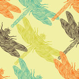 Seamless pattern in retro colors with ornate dragonfly. Royalty Free Stock Photography