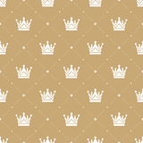 Seamless pattern in retro style with a white crown on a gold background. Can be used for wallpaper, pattern fills, web Royalty Free Stock Images