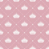 Seamless pattern in retro style with a white crown on a pink background. Can be used for wallpaper, pattern fills, web page backgr Royalty Free Stock Image