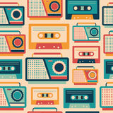 Seamless pattern with retro tape recorders and cassettes. Stock Photo
