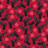 Seamless pattern with revolver, flowers and black hearts. Royalty Free Stock Images
