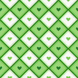 A seamless pattern with rhombs and hearts. Stock Images