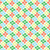 Seamless pattern with rhombus of circles on a white background. Illustration of decorative colorful rhombuses from circles or dots. Repeating spots in the form Stock Photos