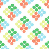 Seamless pattern with rhombus of circles on a white background. Illustration of decorative colorful rhombuses from circles or spots. Repeating spots in the form Stock Photography