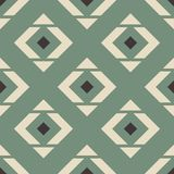 Seamless pattern with rhombuses and triangles in beige, brown and green. Stock Photography