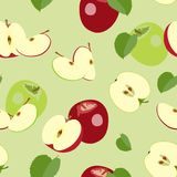 Seamless pattern of ripe halves and whole apples. Vector illustration. Vector colored pattern of red and green whole apples and halves with leaves. Ripe fruit Stock Photos