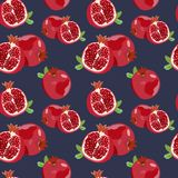 Seamless pattern with ripe pomegranate on a blue background. Vector illustration. Vector colored pattern with a juicy pomegranate on a dark blue background. For Royalty Free Stock Photo