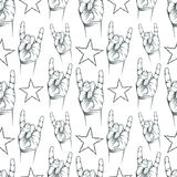 Seamless pattern with Rock n Roll sign and a stars Stock Photography