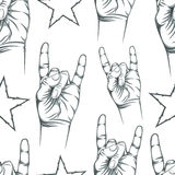 Seamless pattern with Rock n Roll sign and a stars Royalty Free Stock Image