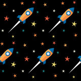 Seamless pattern. Rockets and stars over black background. Stock Image