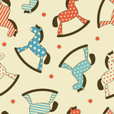 Seamless pattern with rocking horses Royalty Free Stock Images