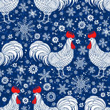 Seamless  pattern with rooster silhouette and snowflakes. Rooster- animal symbol of new year 2017. Stock Image