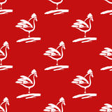 Seamless pattern with roosters. Drawn cocks brush on the red bac Royalty Free Stock Images