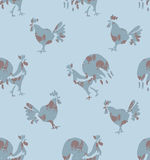 Seamless pattern Roosters and Hens. Hand drawn Roosters and Hens. Seamless pattern of bird silhouettes on a dusty blue background Royalty Free Stock Photography