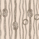 Seamless pattern of ropes with marine knots Royalty Free Stock Image
