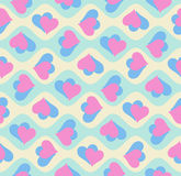 Seamless pattern with rotating pairs of hearts. Stock Photography