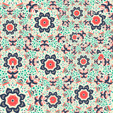 Seamless  pattern of round ornaments and abstract flowers. Stock Images