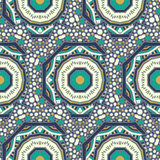 Seamless  pattern of round ornaments and other abstract elements. Stock Image